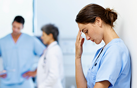 Image of a tired nurse
