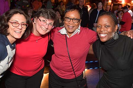 Network Like a Pro at Your Next Conference - a group of women with their arms around each other smiling at the camera