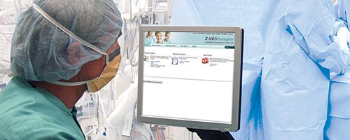 Perioperative nurse reviewing a computer monitor in the operating room