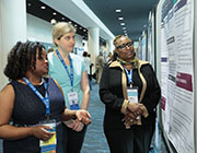 Expo attendees at poster exhibit